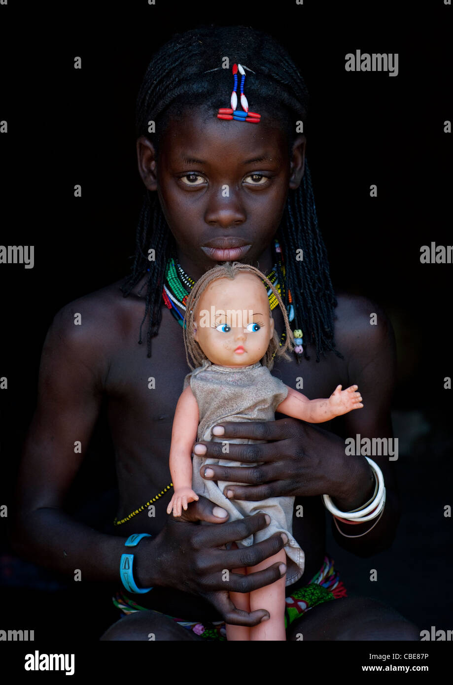 Misses Chioveni, A Mucawana Girl Showing Her Western Doll, Village Of Soba, Angola - Stock Image