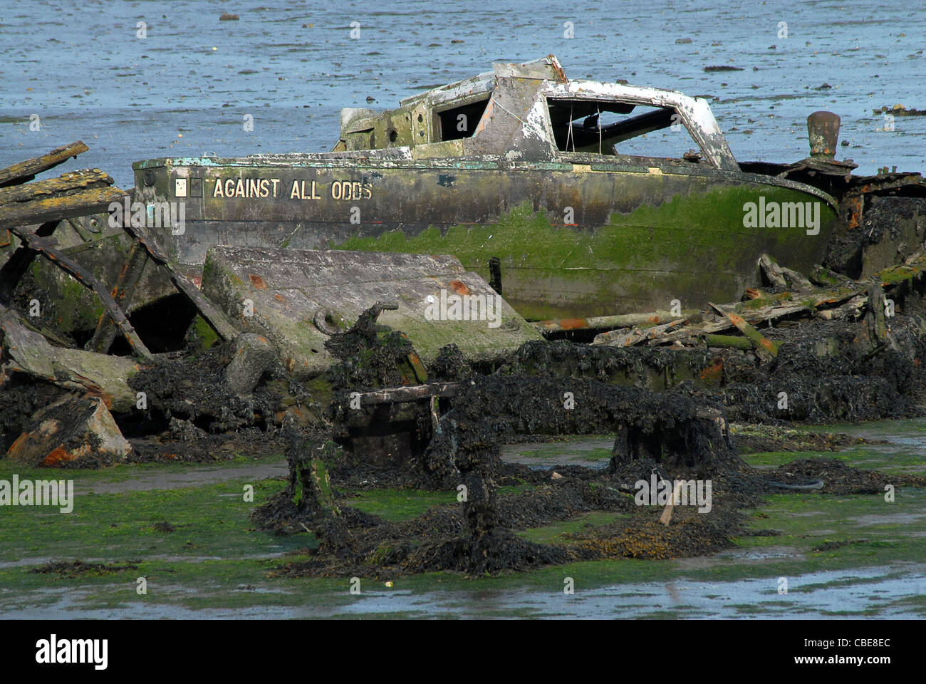 WRECKED BOAT,  AGAINST ALL ODDS PORTCHESTER, HAMPSHIRE. - Stock Image