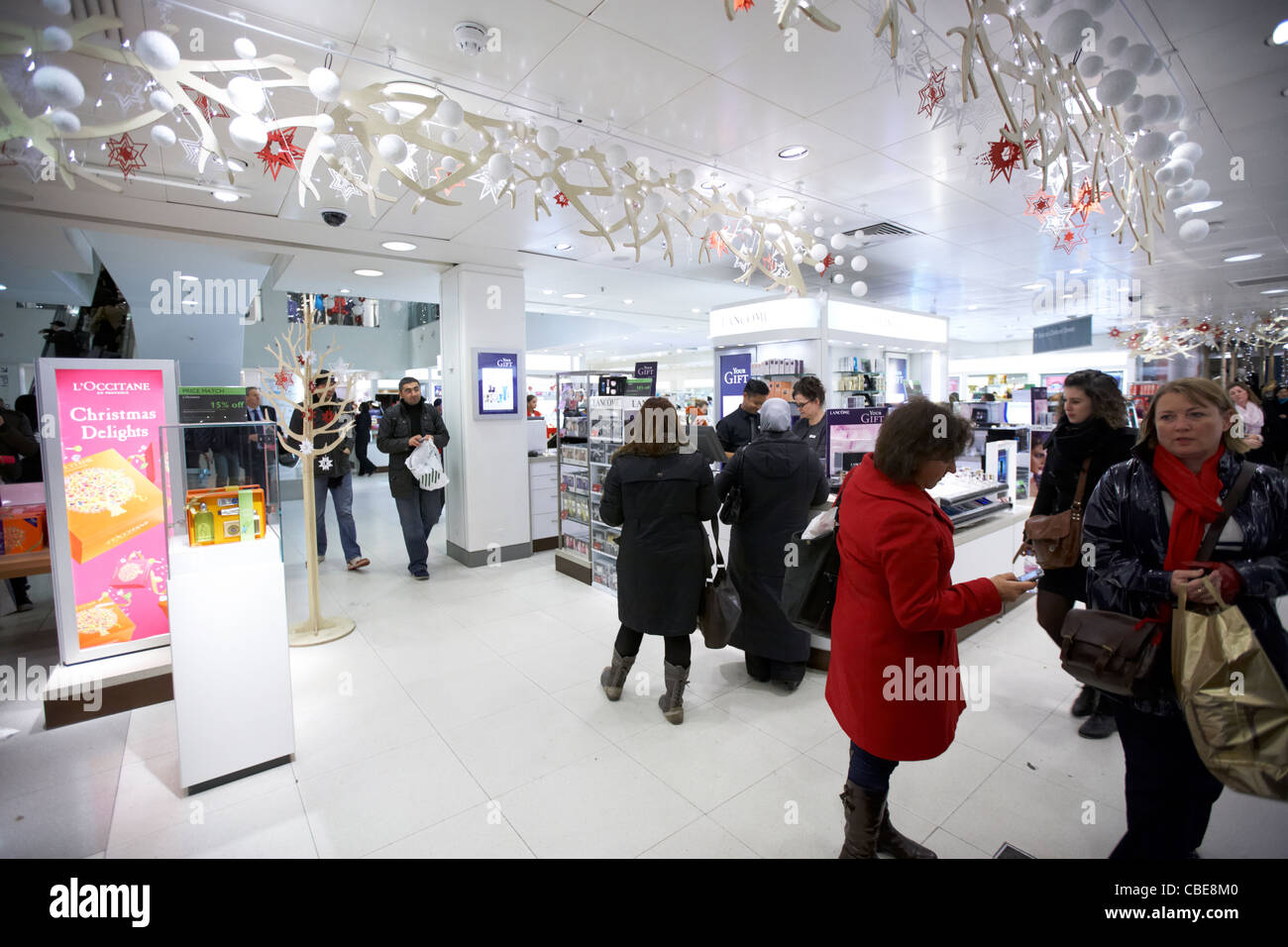 shoppers in the perfume section of john lewis department store oxford street christmas shopping london england united - Stock Image