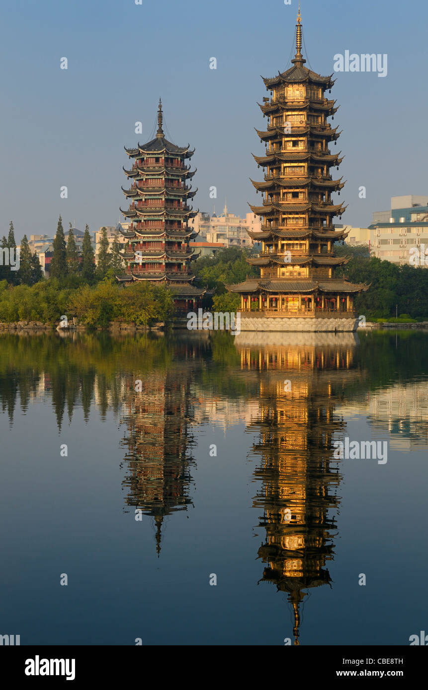 Sun and Moon multi-level Pagodas on Shanhu or Fir Lake in early morning Guilin China - Stock Image