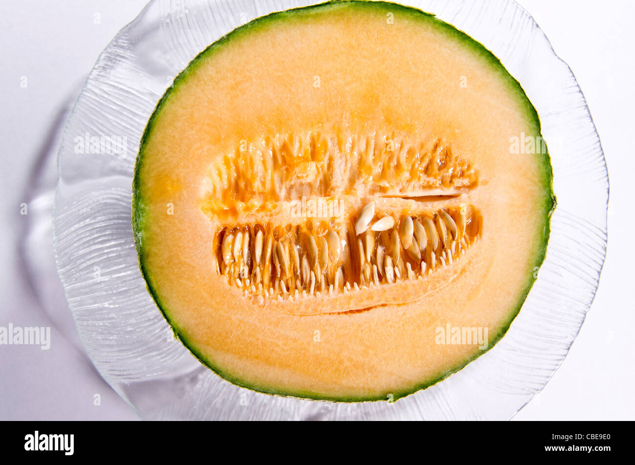 Half A Cantaloupe Cut Open Seeds Inside Sitting On A Glass Plate Stock Photo Alamy Cantaloupes are an excellent source of vitamin c and a. https www alamy com stock photo half a cantaloupe cut open seeds inside sitting on a glass plate 41496728 html