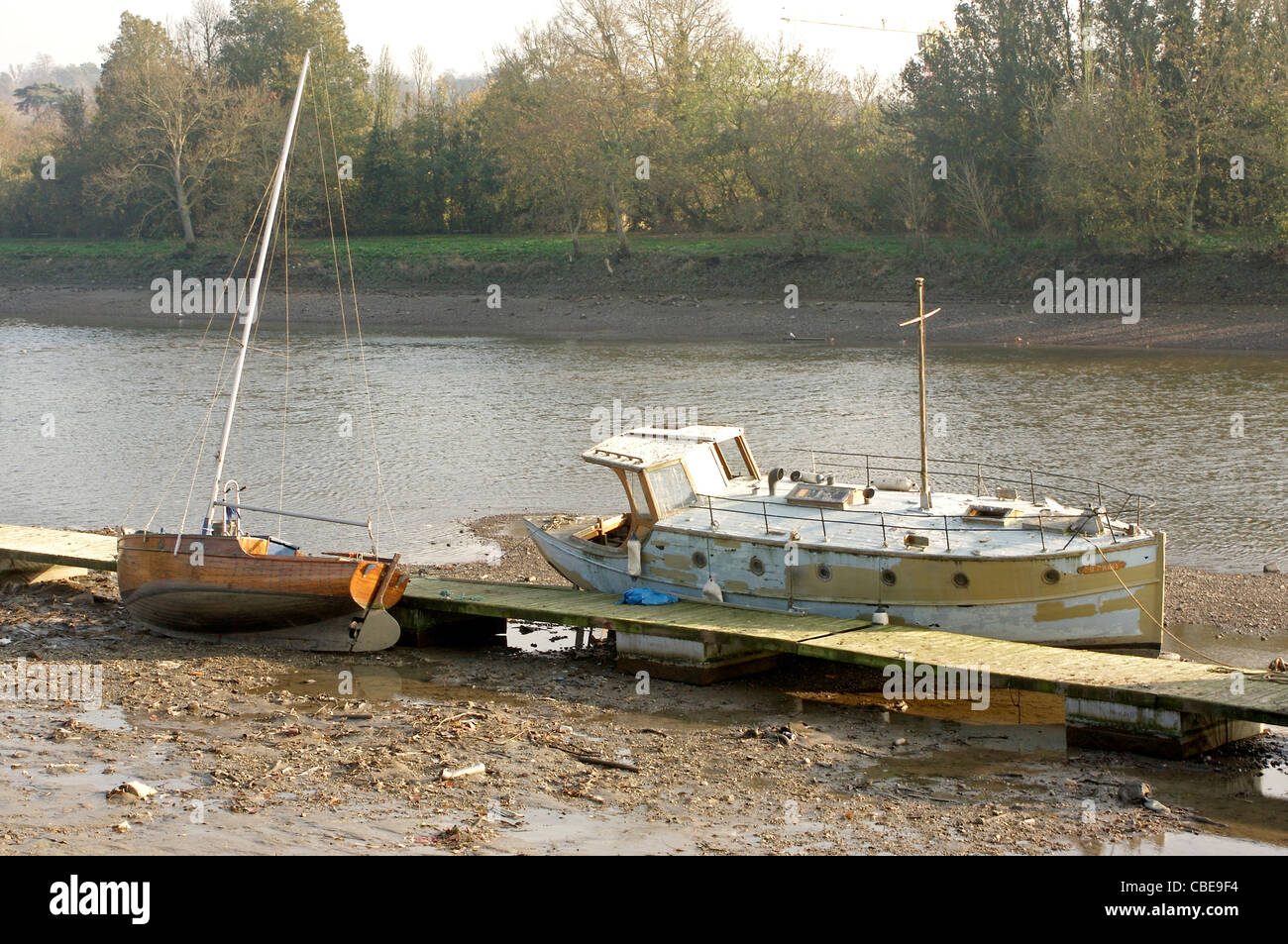 Two boats aground during low tide along the River Thames in Richmond Upon Thames, West London, England - Stock Image