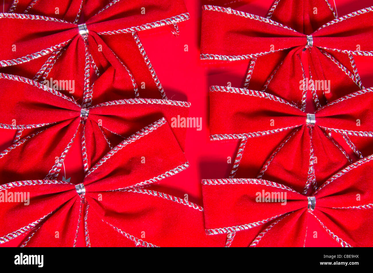 Red bows on a red background - Stock Image