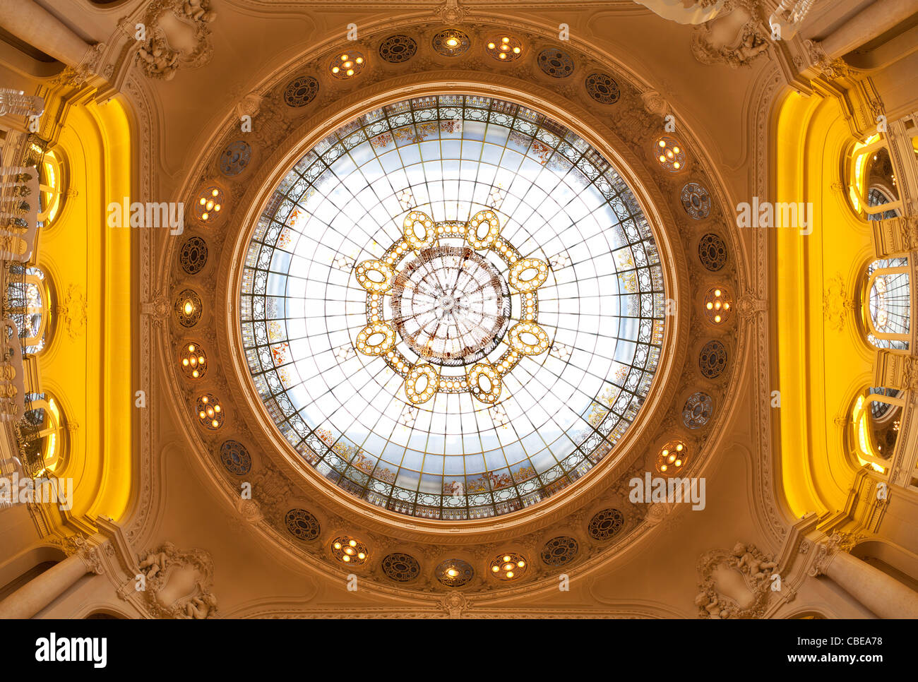 The Berlioz lounge ceiling and glass roof of the Vichy's opera house (France). Plafond et verrière du salon - Stock Image