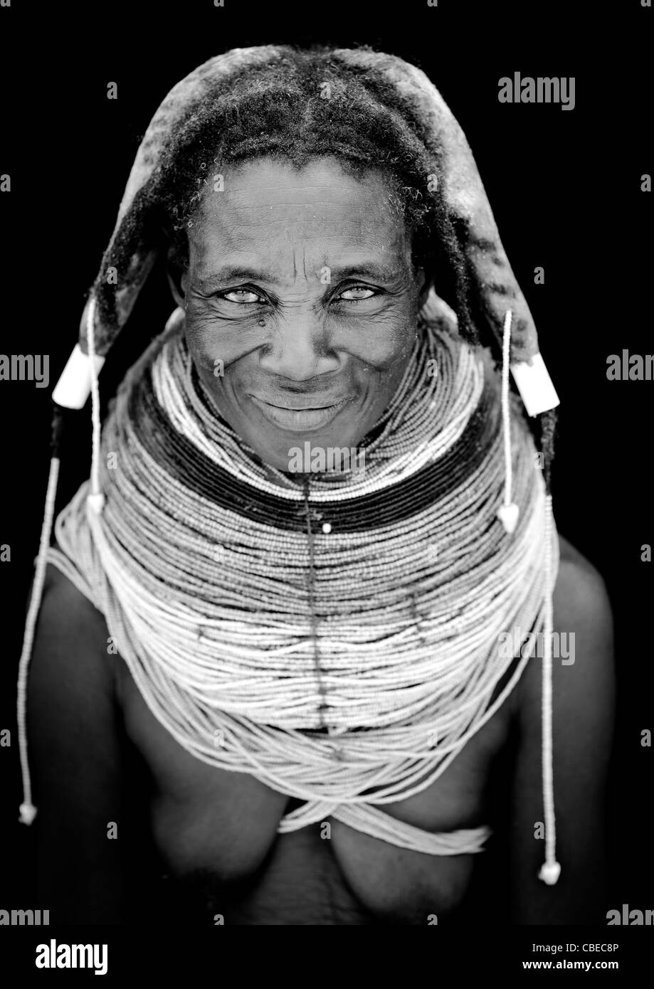 Old Mwila Woman With The Giant Vilanda Necklaces, Chibia Area, Angola - Stock Image