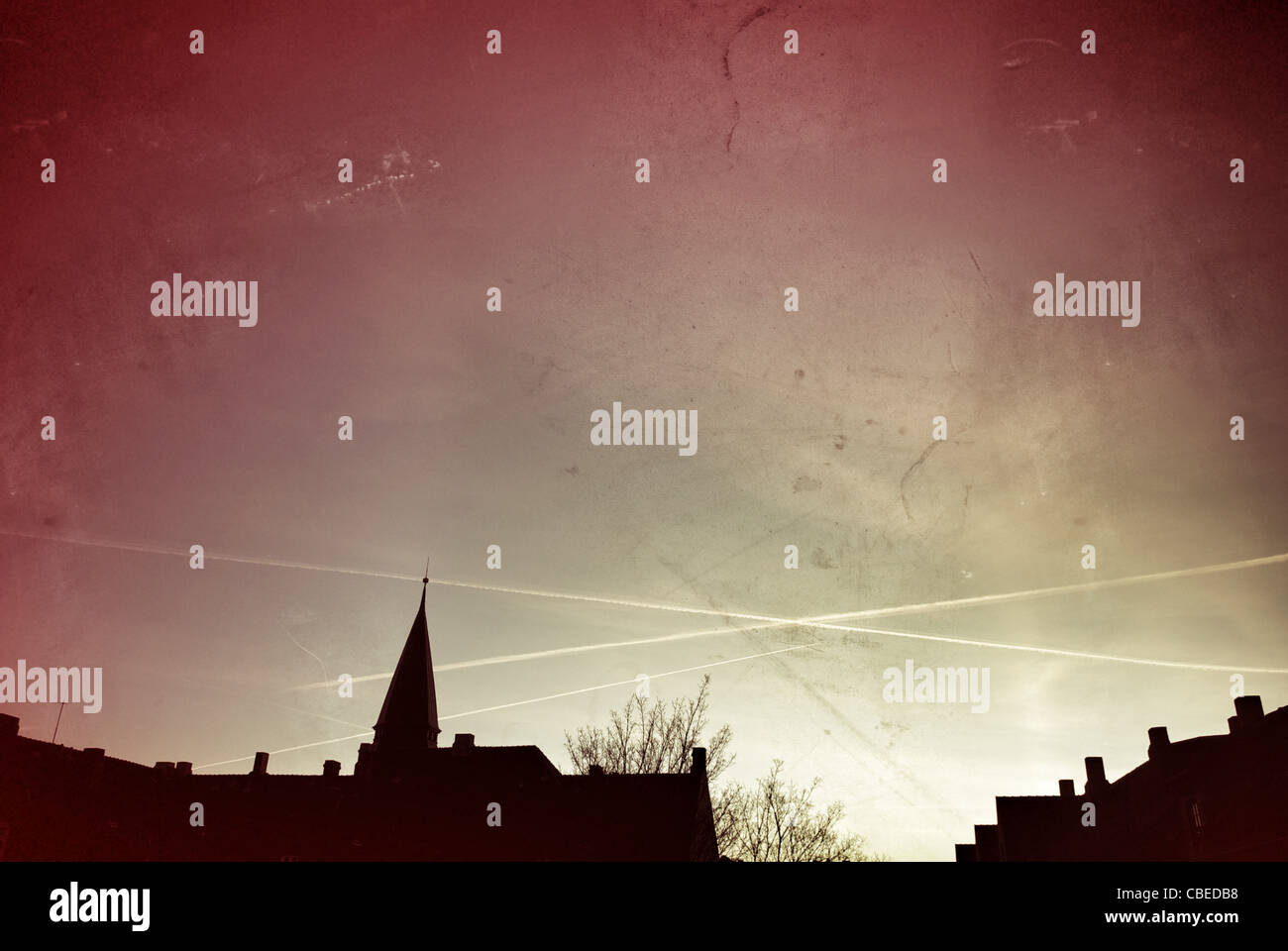 URBAN SUNRISE WITH VAPOR TRAILS - Stock Image