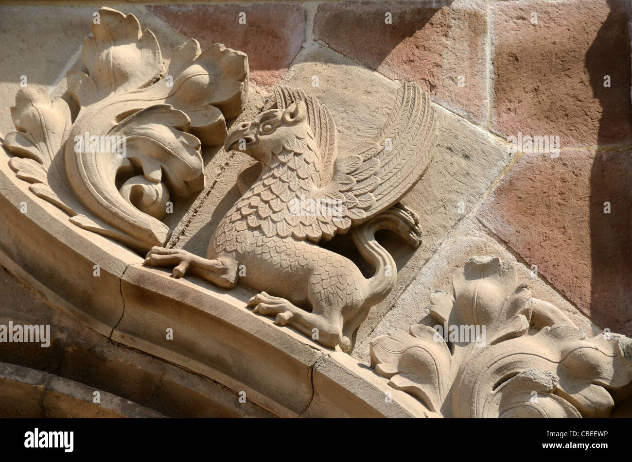 Stone Carving of Dragon, Griffin, Griffon or Gryphon at Entrance to Saint-Léonce Cathedral Frejus France - Stock Image