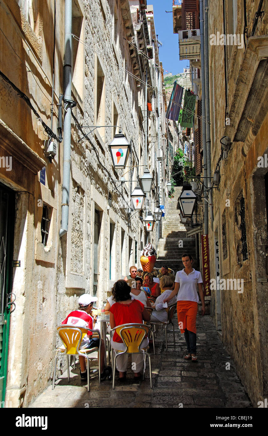 DUBROVNIK, CROATIA. Customers eating at a gelateria on a narrow side street off Stradun in the walled old town. Stock Photo
