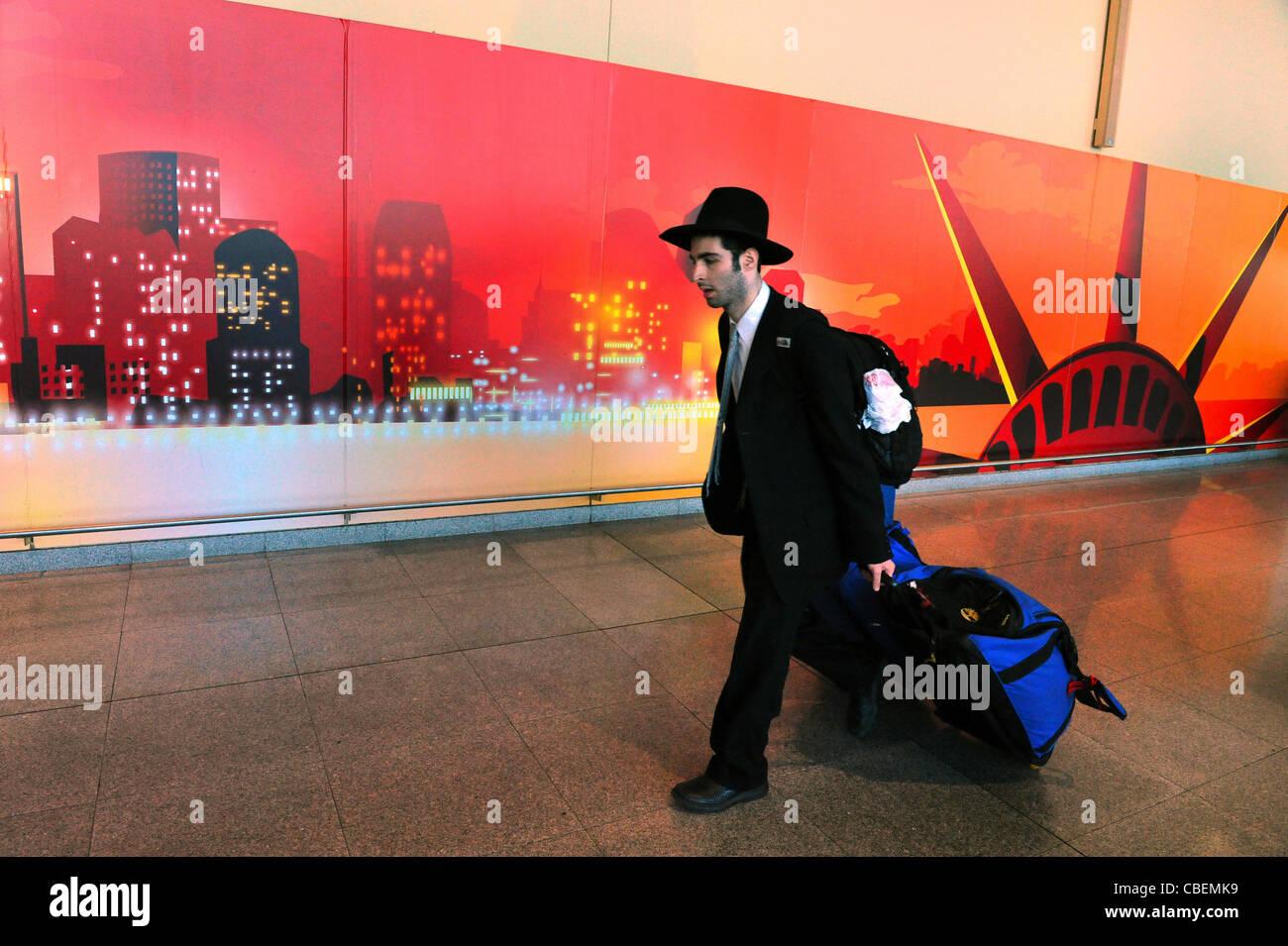 Orthodox Jewish men arriving to New York via J.F.K Airport. Stock Photo