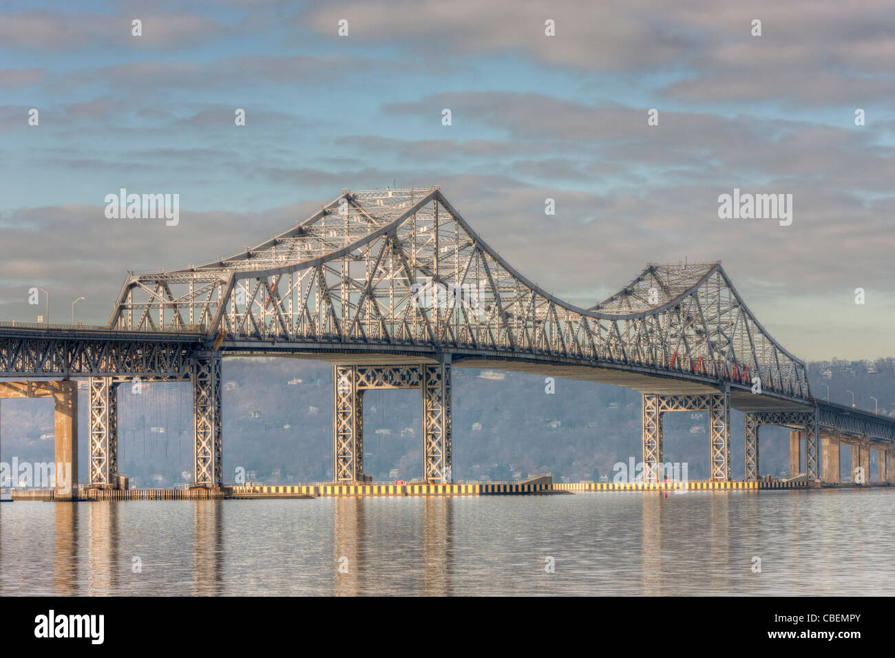 The Tappan Zee Bridge spans the Hudson River under a partly cloudy morning sky as seen from Tarrytown, New York. - Stock Image