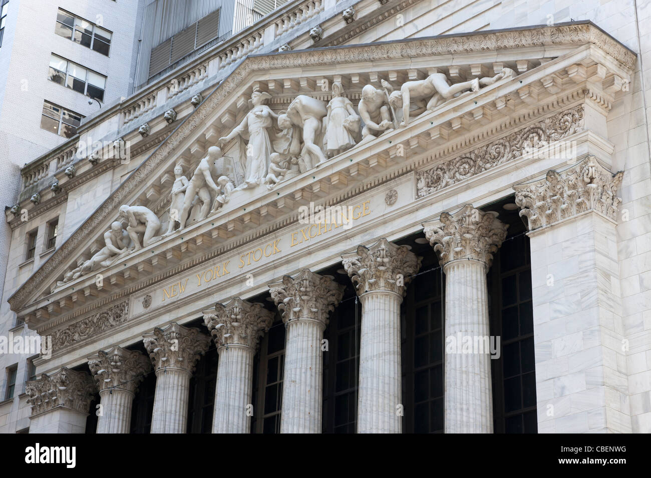 The neoclassical New York Stock Exchange on Wall Street featuring the pediment Integrity Protecting the Works of - Stock Image