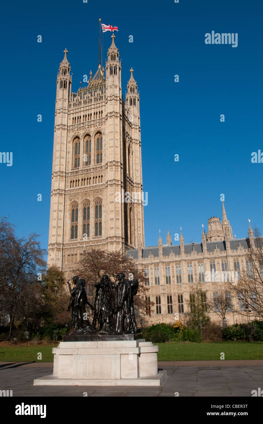 The Burghers of Calais Sculpture by Rodin and The Victoria Tower at The Palace of Westminster, London, England, - Stock Image