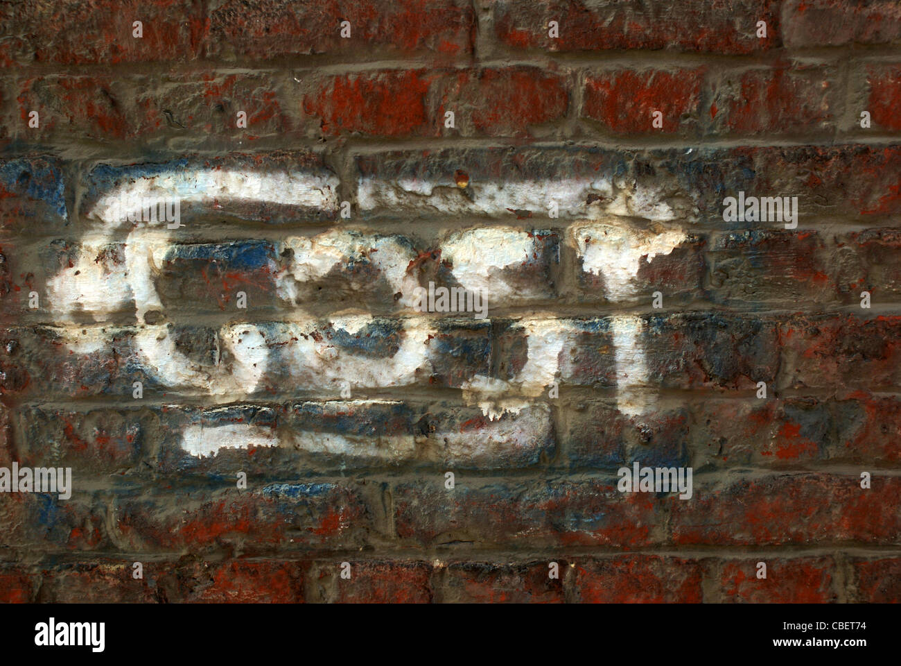 Lost word written on a brick wall - Stock Image