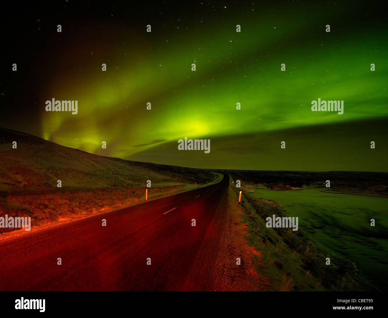 Aurora Borealis over road, Iceland - Stock Image