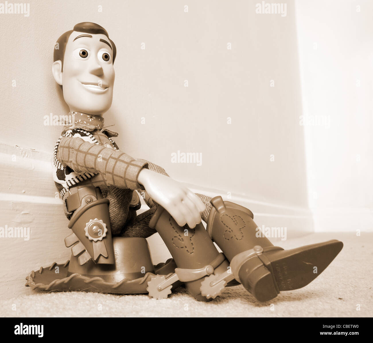 Toy story woody sitting on his hat - Stock Image