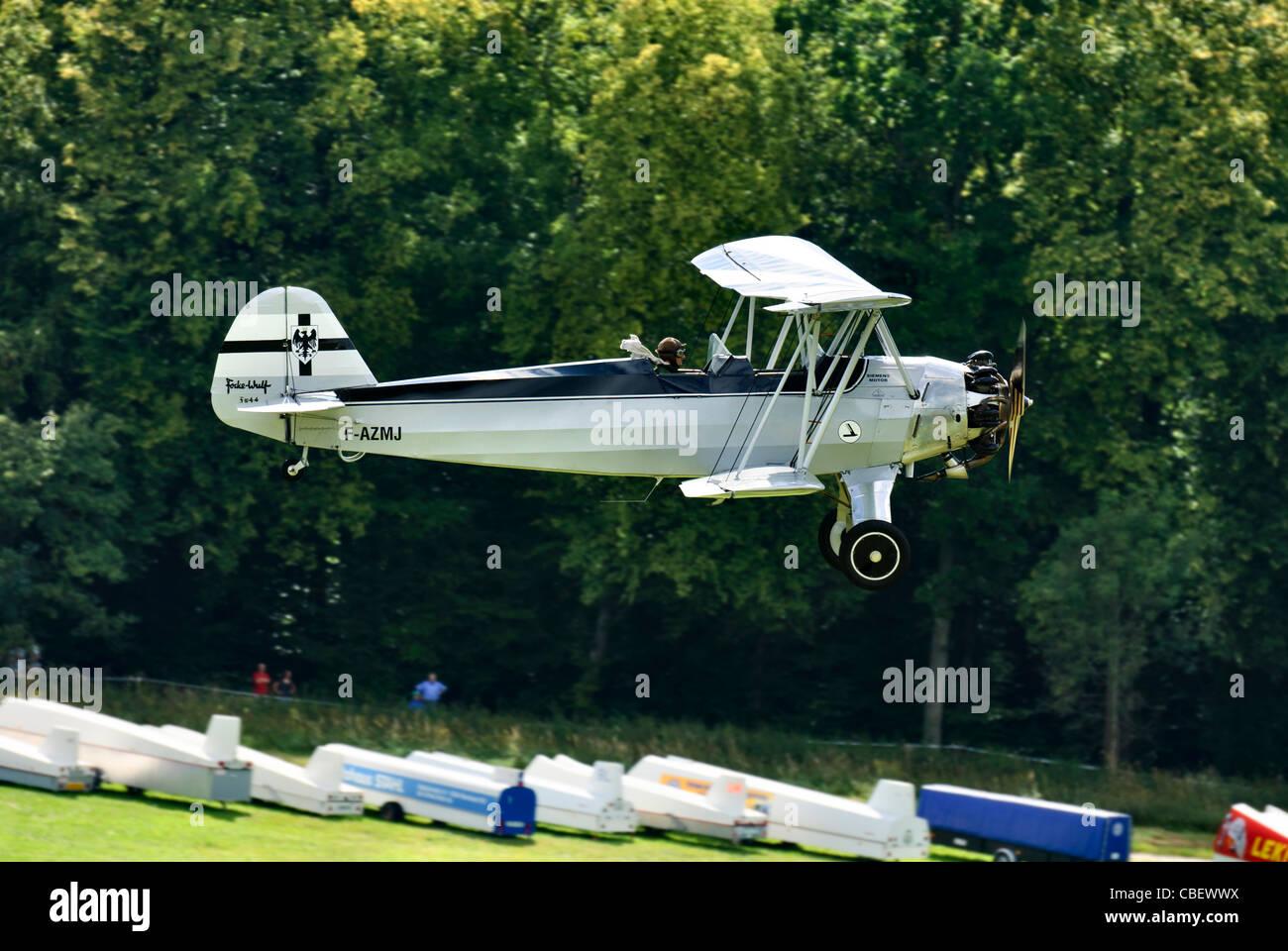 "Focke-Wulf FW 44 Stieglitz ""1940"" landing at the Hahnweide vintage air show, Kirchheim-Teck, Baden Württemberg, - Stock Image"