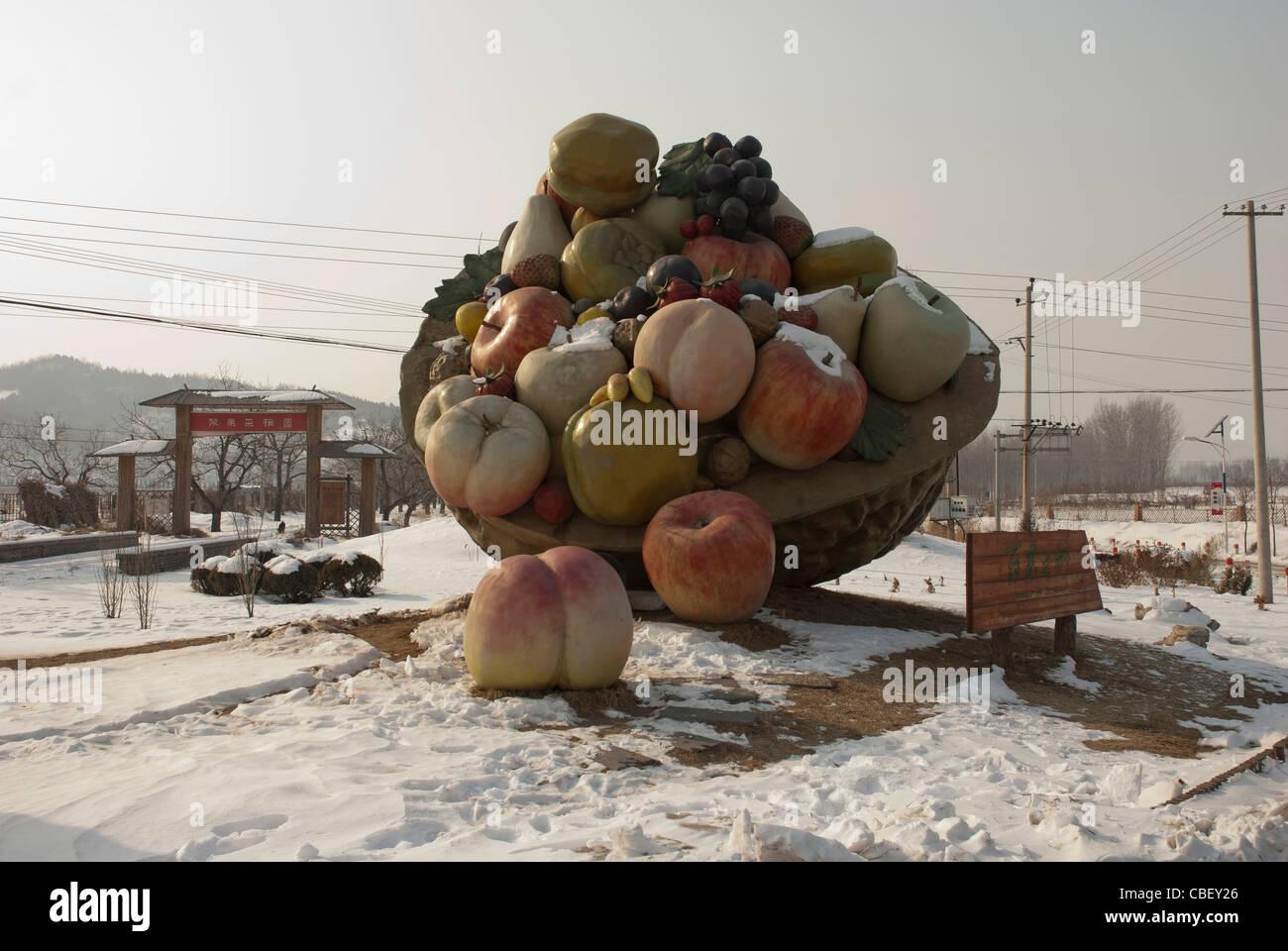 Monumental sculpture in a Chinese village symbolizing abundance - Stock Image