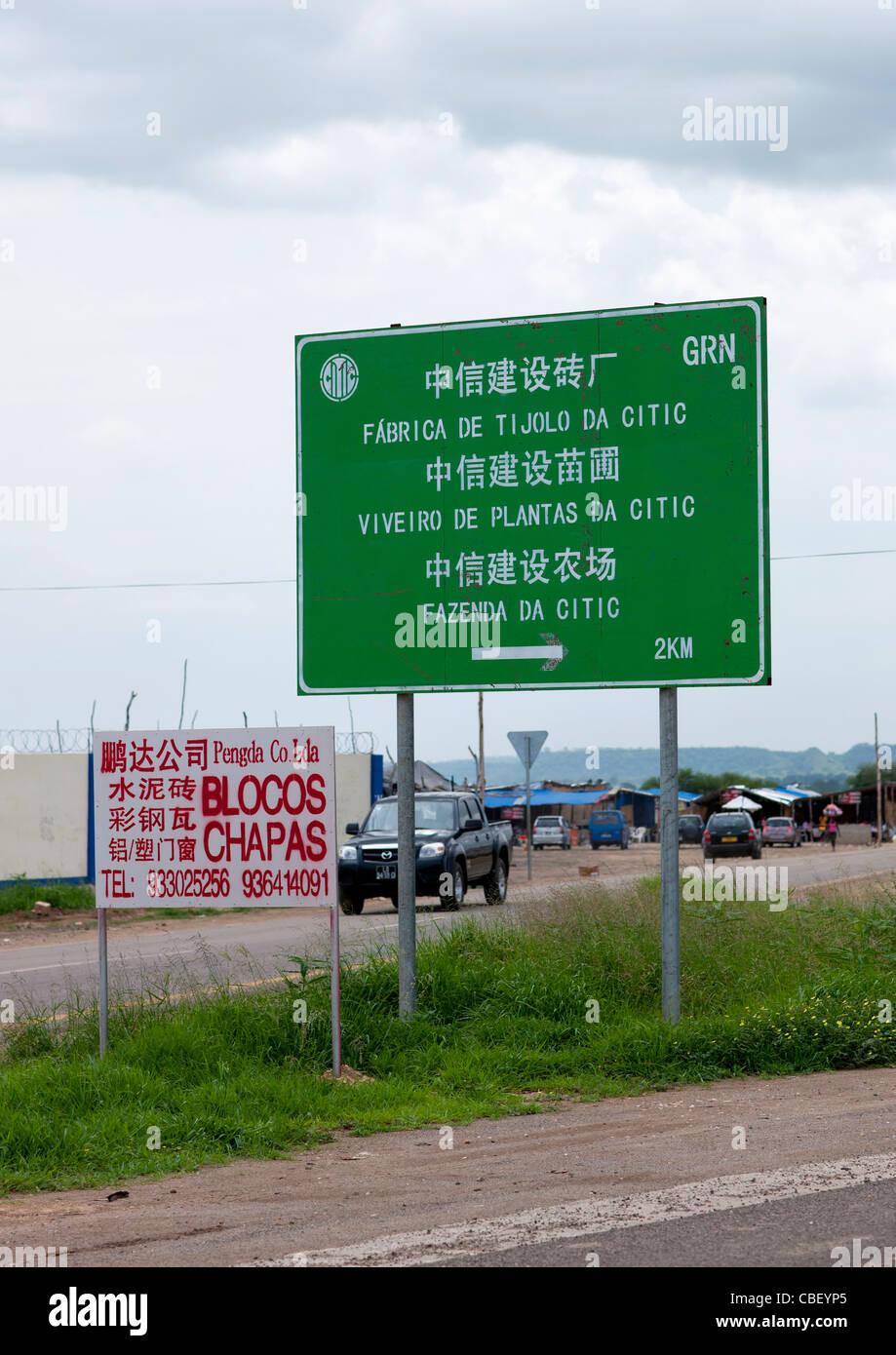 Road Sign Indicating Chinese Companies, Luanda, Angola - Stock Image