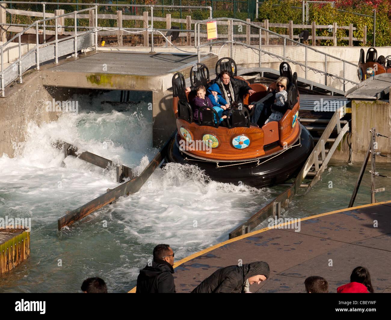 Visitors, in the river splash ride in Legoland, Berkshire, UK Stock Photo
