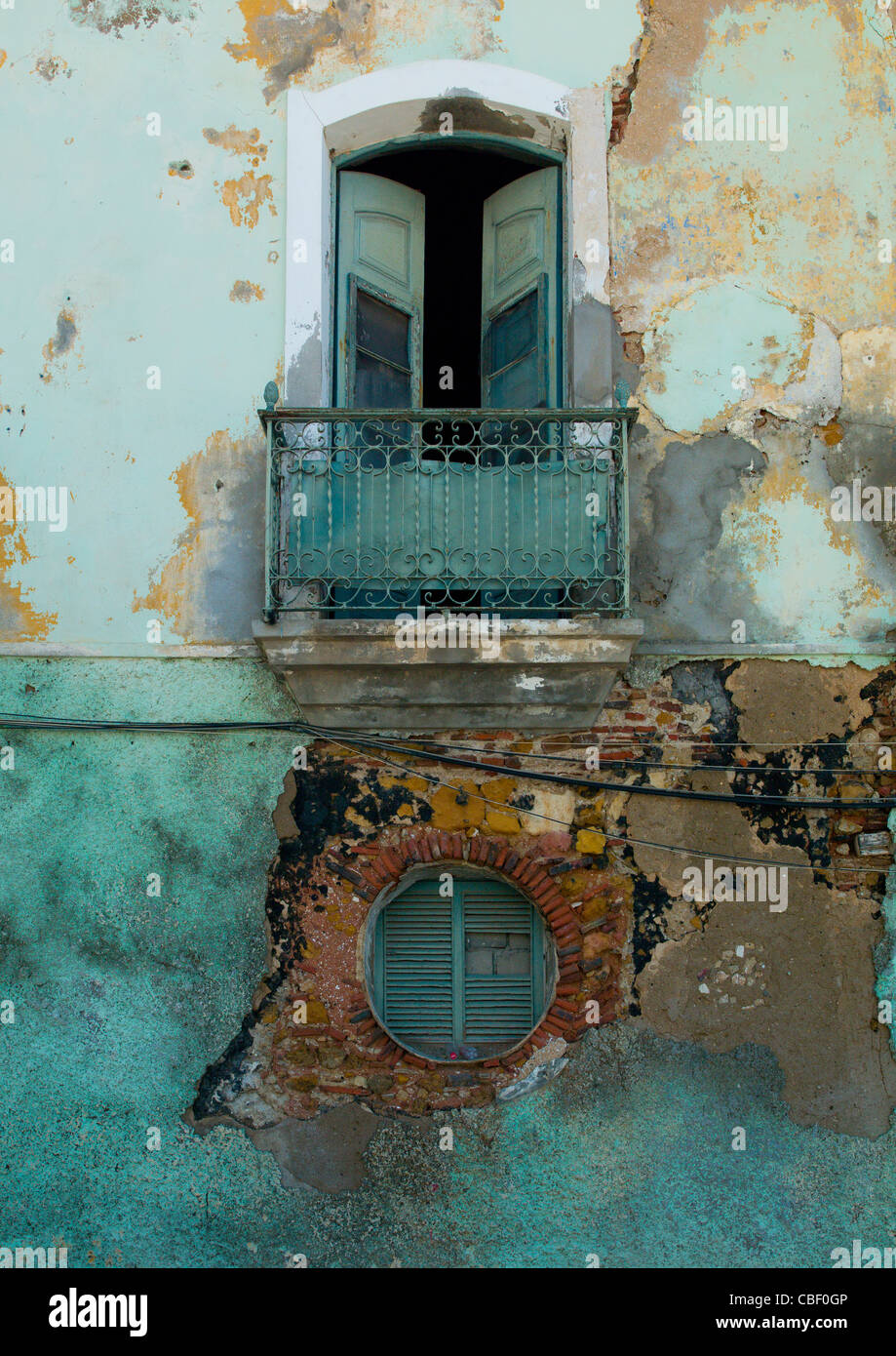 Balcony Of A Dilapidated Old Colonial House, Luanda, Angola - Stock Image