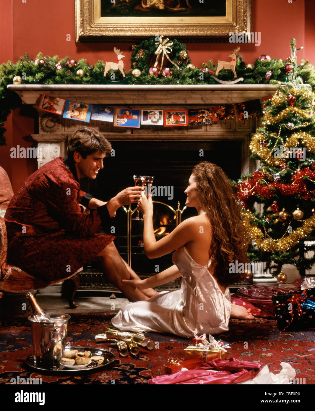Christmas Couple By An Open Log Fire Stock Photo 41511876 Alamy