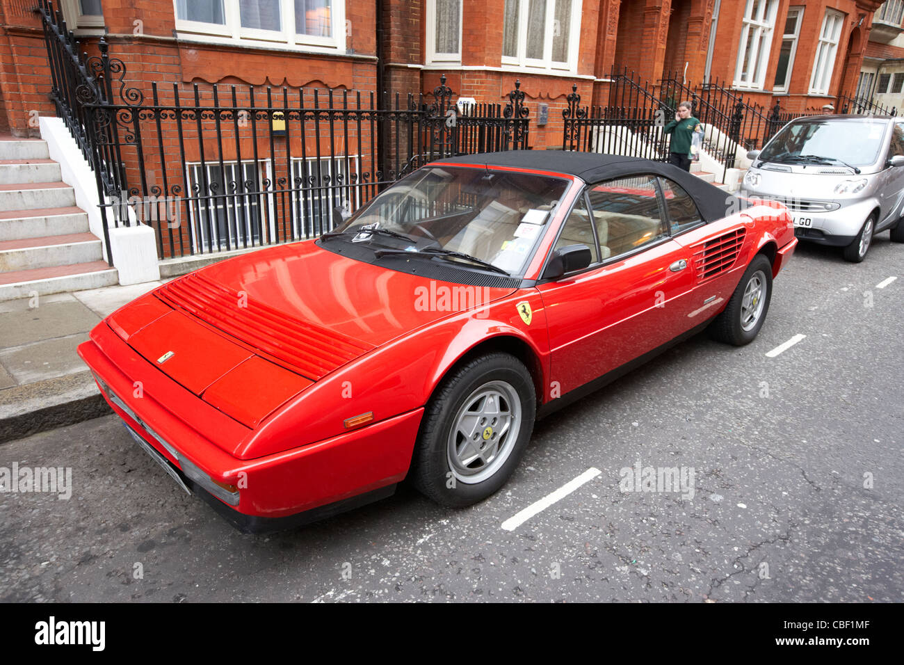 ferrari convertible parked in a kensington and chelsea resident parking bay london england uk united kingdom - Stock Image