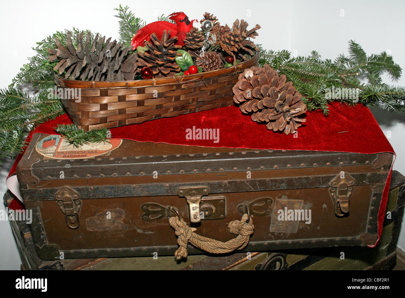 Old suitcase with Christmas decorations - Stock Image