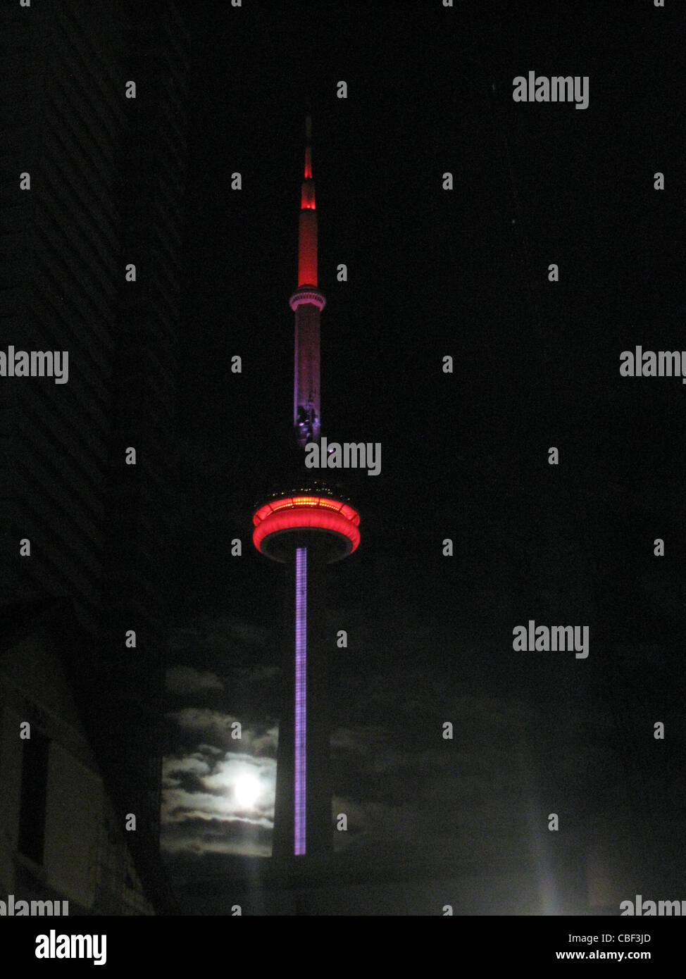 CN tower lite up at night Stock Photo