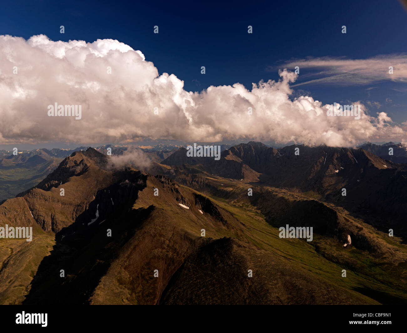 White clouds over the Chugach Mountains in Alaska, USA - Stock Image