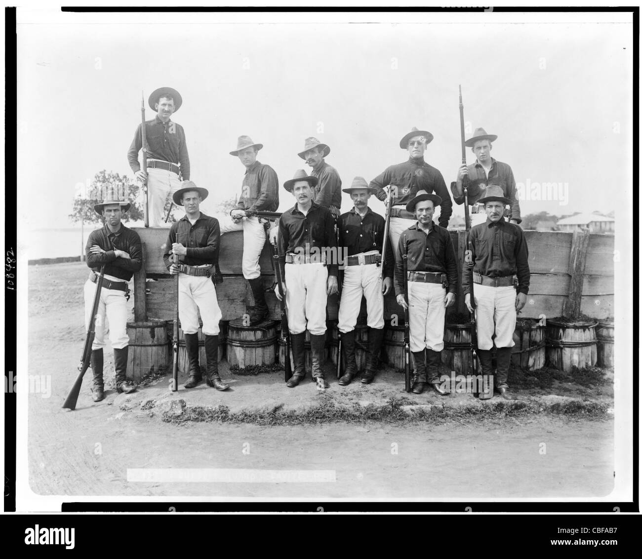 Eleven American soldiers(?) posed, Cavite, Philippine Islands. 1899 - Stock Image