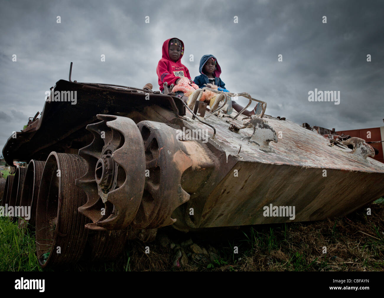 Kids On A Tank Wreck From Civil War, Angola - Stock Image