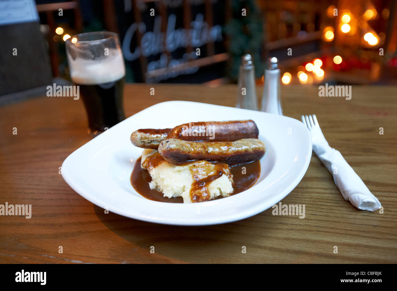 bangers and mash and a pint of stout in a gastro pub in london england united kingdom uk - Stock Image