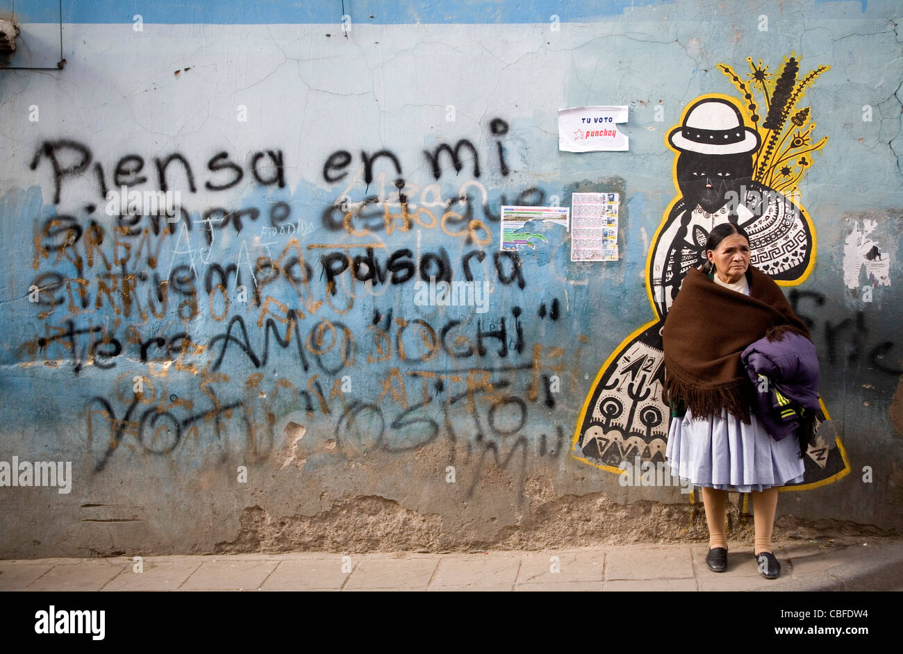 Bolivian woman standing in front of a wall mural in Potosi' Bolivia - Stock Image