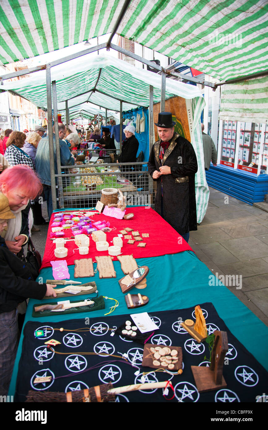 Louth Victorian Market,  Lincolnshire, England stall holder selling pagan magic items and wooden carvings - Stock Image