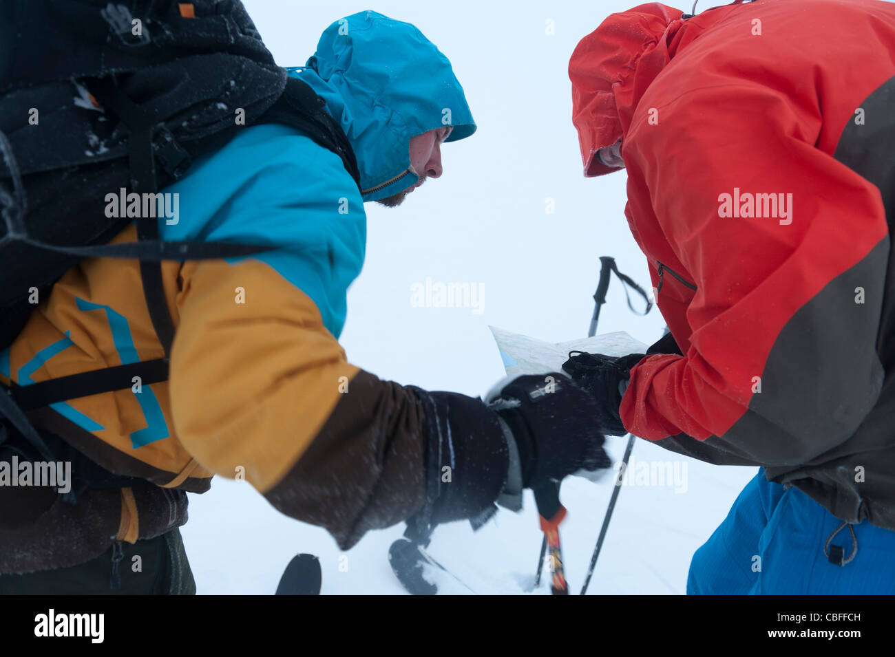 Two men orienteering in foggy conditions while ski-touring in Tamok, north Norway Stock Photo