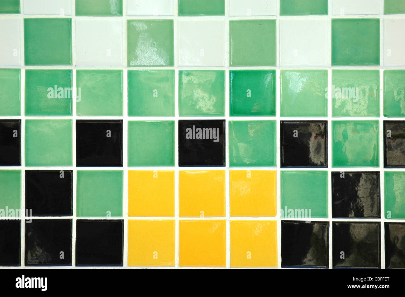 Old ceramic tiles in yellow green black and white stock photo old ceramic tiles in yellow green black and white dailygadgetfo Choice Image