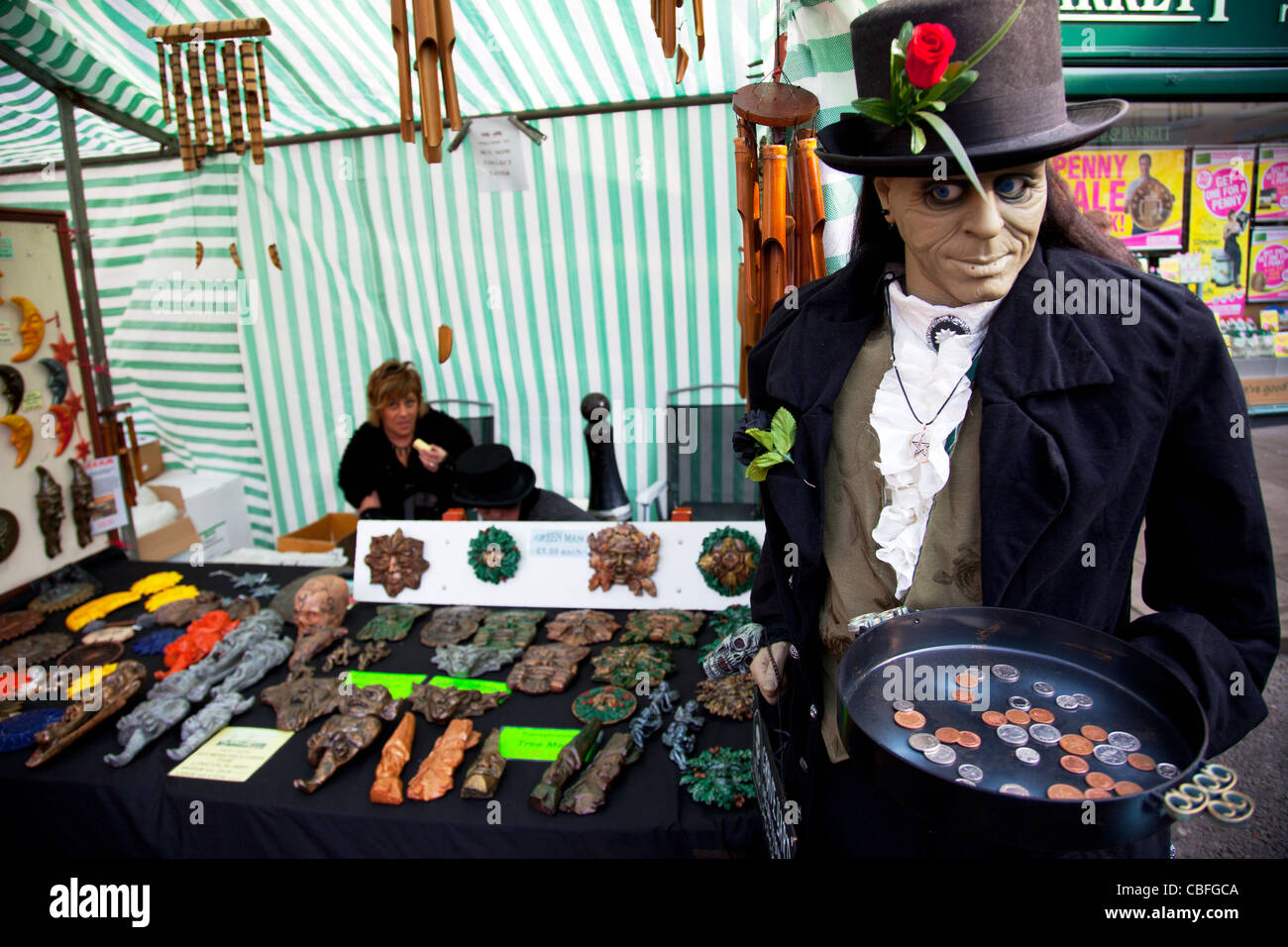 Louth Victorian Market,  Lincolnshire, England pagan gods plaques and goods wind chimes, scary man with a tray of - Stock Image