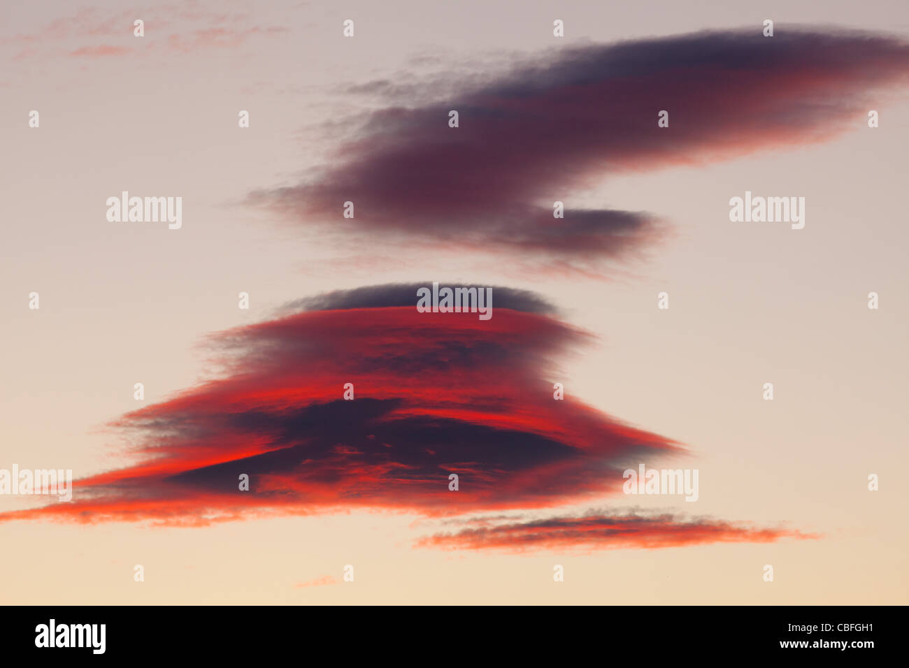 Strange formation of clouds at sunset - Stock Image