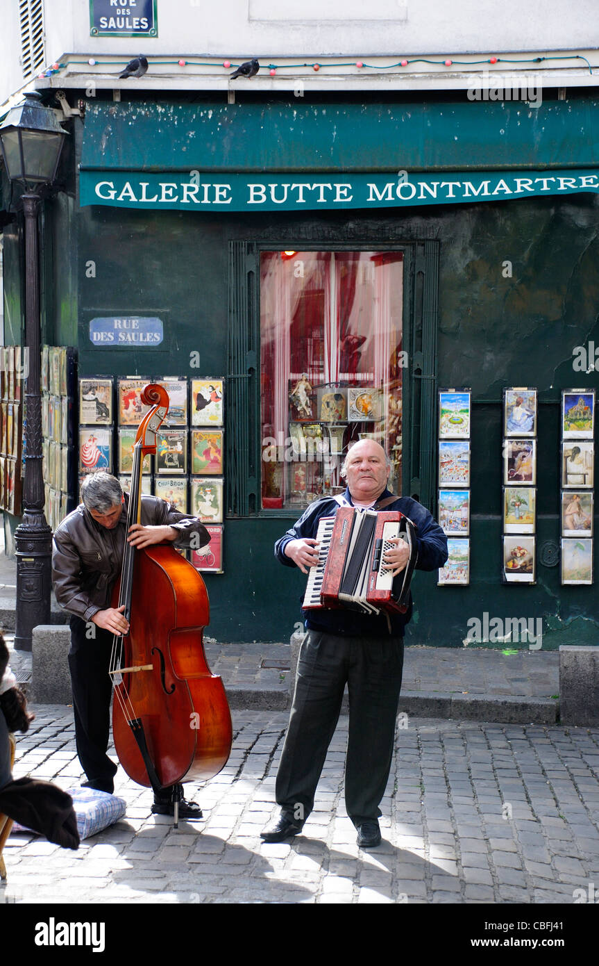 Two men playing instruments on Paris street in Montmartre - Stock Image
