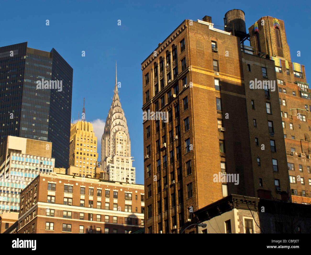 Top of Chrysler Building and Brownstone Building downtown Manhattan, New York City, New York, USA, Anthony Arendt - Stock Image