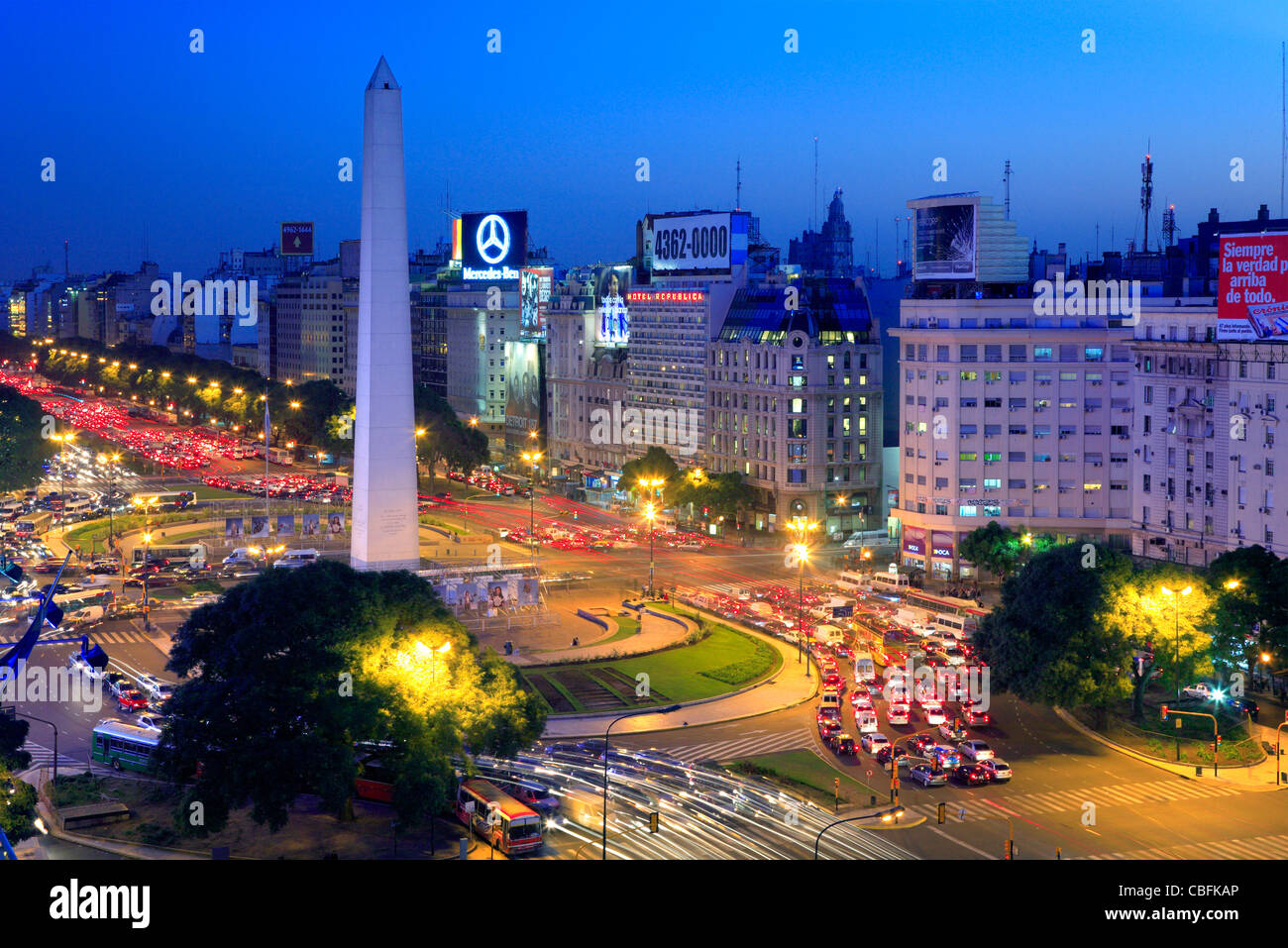 9 de Julio Ave. aerial view, and Obelisk (obelisco) and car lights traces, at twilight. Buenos Aires, Argentina, - Stock Image