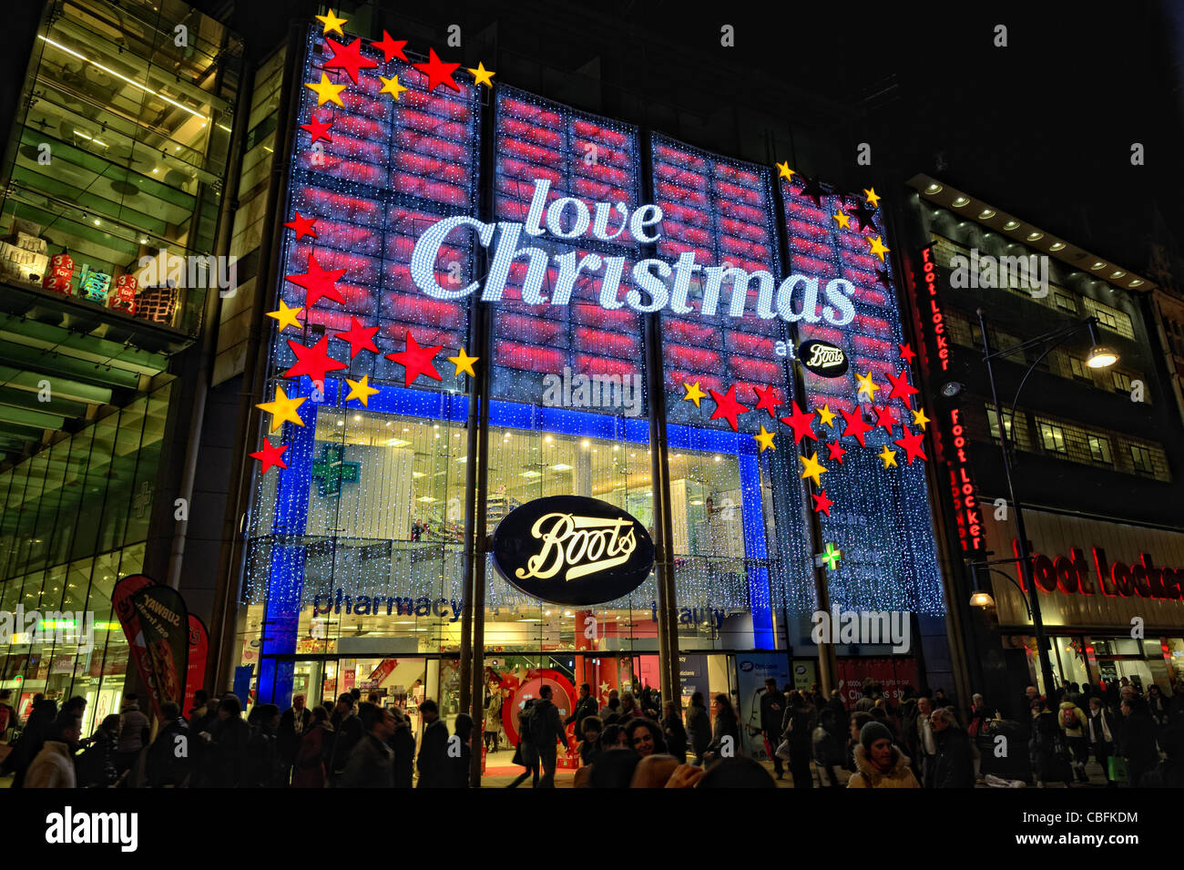 Boots the Chemist store, Oxford Street, London, England, UK, in Christmas lights - Stock Image