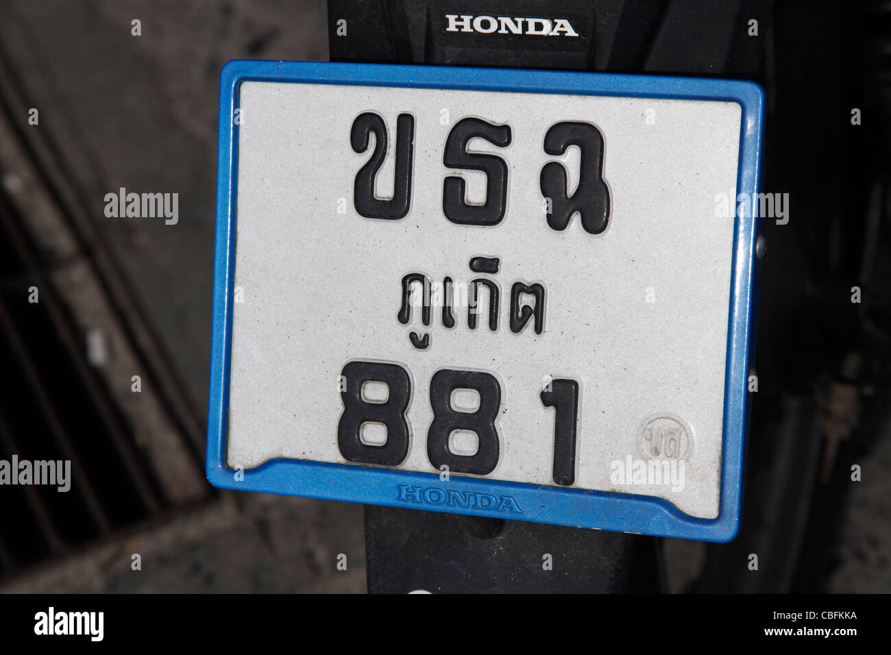 Moped vehicle registration plate with Thai characters and writing looking like USA in Patong, Phuket, Thailand - Stock Image