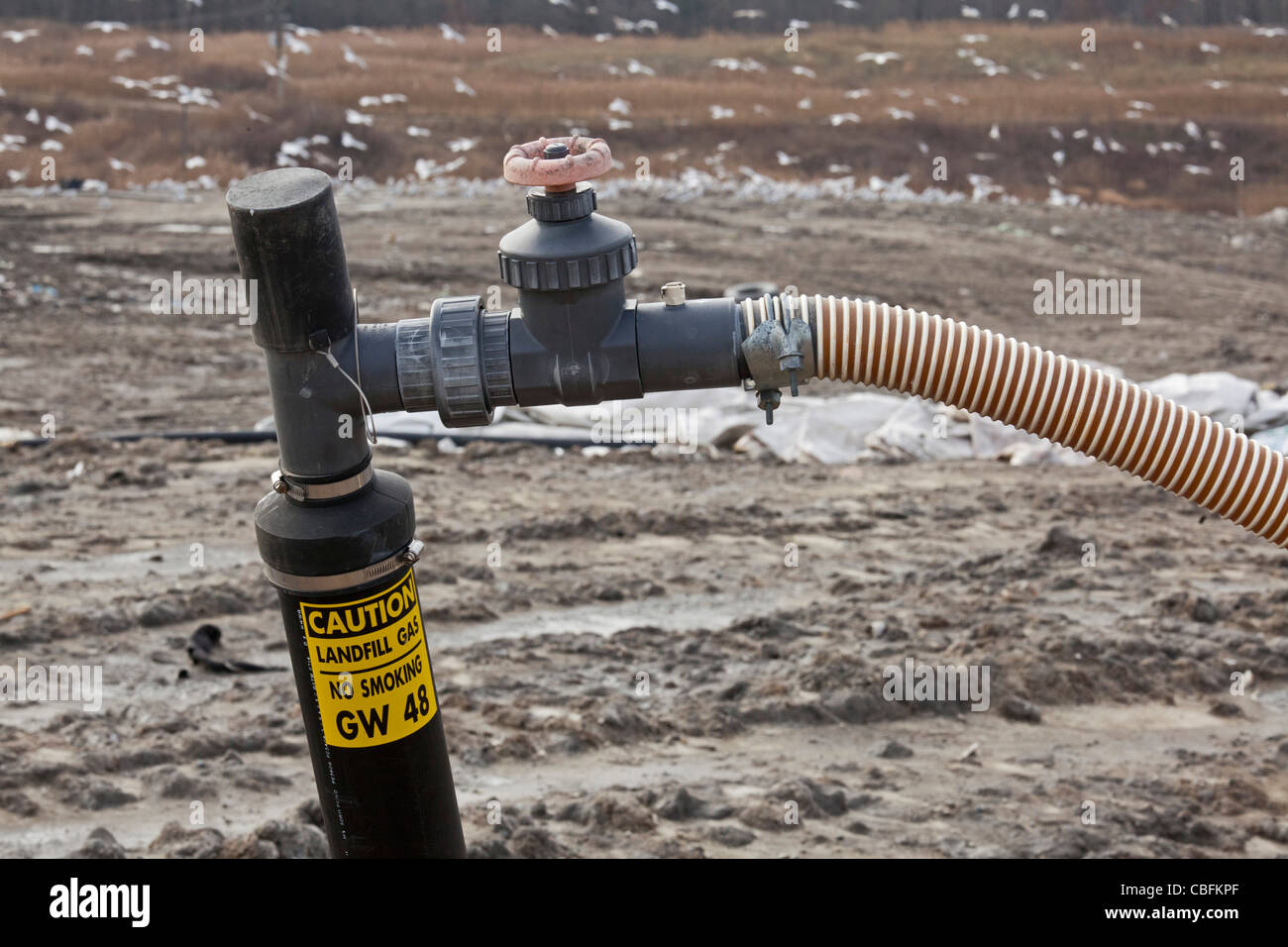 A well collects methane gas from decaying garbage at St. Clair County's Smith's Creek Landfill. - Stock Image