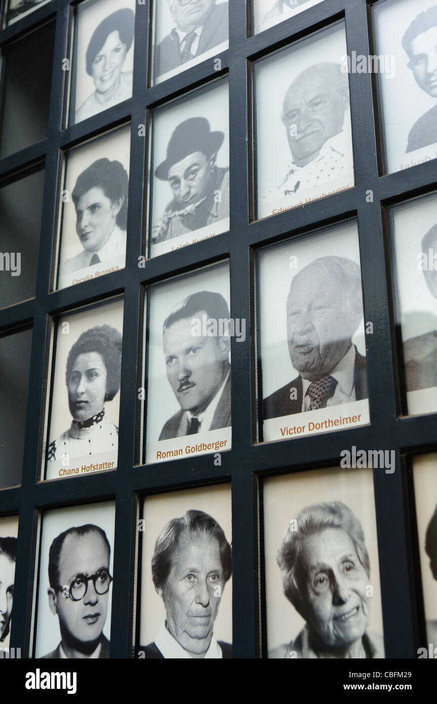 Pictures of Jewish victims of the Nazi holocaust on the windows of the Oskar Schlinder factory, Krakow Stock Photo