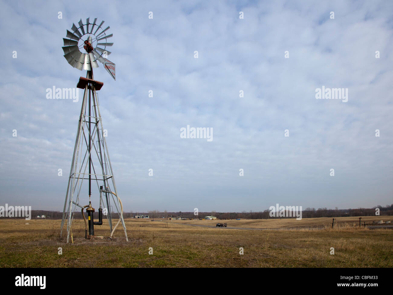 A windmill pumps methane gas from decaying garbage at St. Clair County's Smith's Creek Landfill. - Stock Image