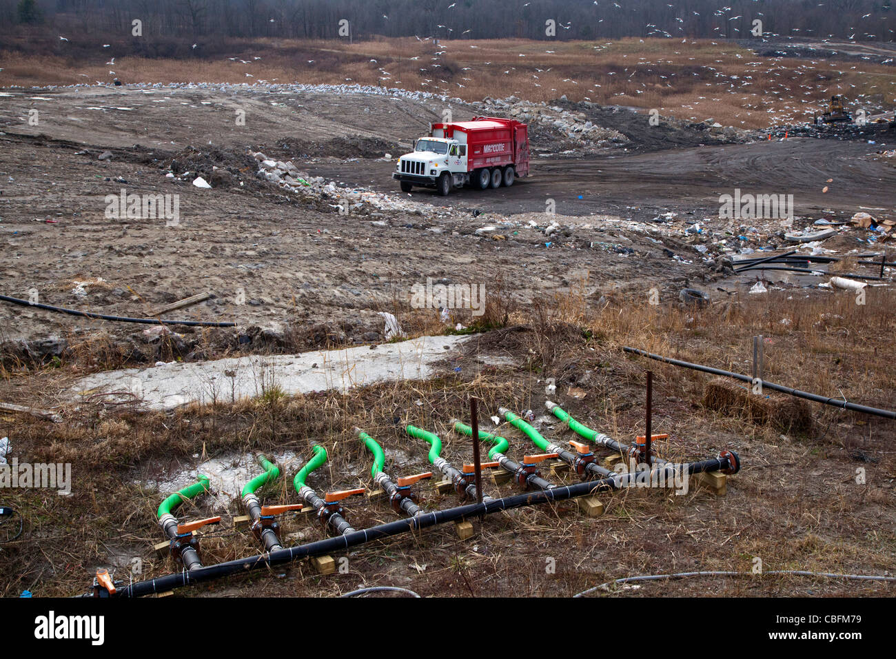 Material collected from septic tanks is injected through green pipes into St. Clair County's Smith's Creek Landfill. Stock Photo