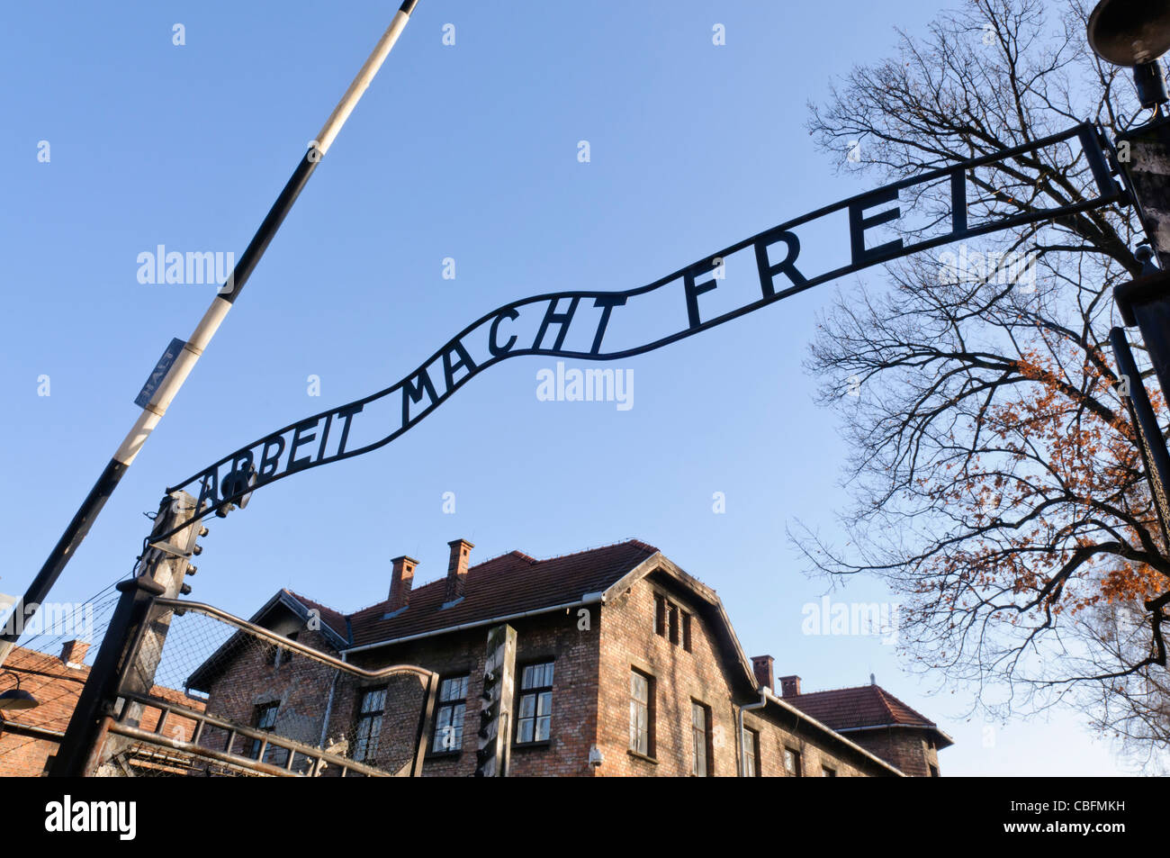 Main entrance to Auschwitz I Nazi concentration camp with sign 'Arbeit Macht Frei' - Stock Image