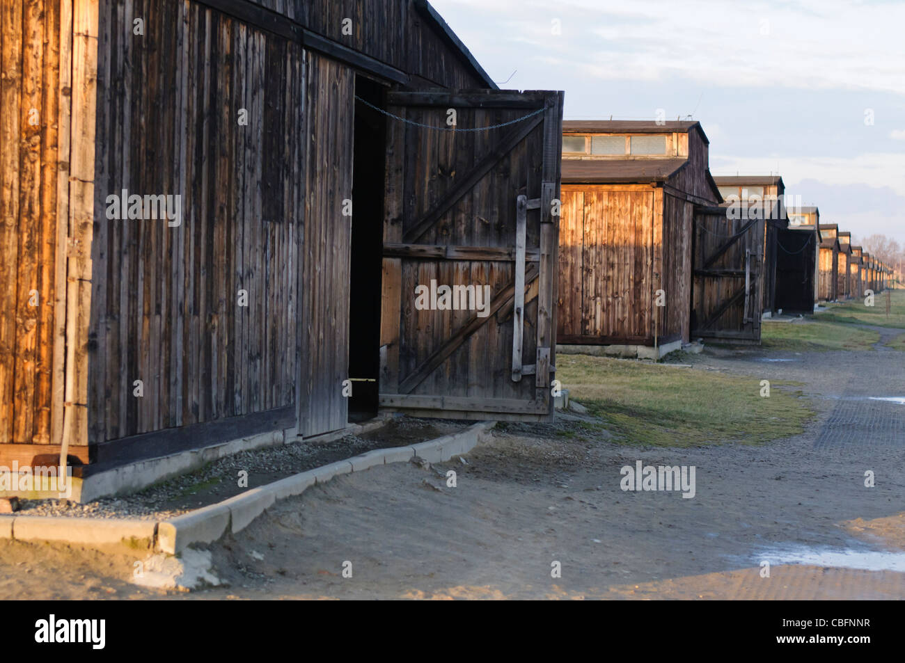 Wooden barracks in Auschwitz Berkenhau II concentration camp, each designed to hold 550 prisoners, but in reality - Stock Image
