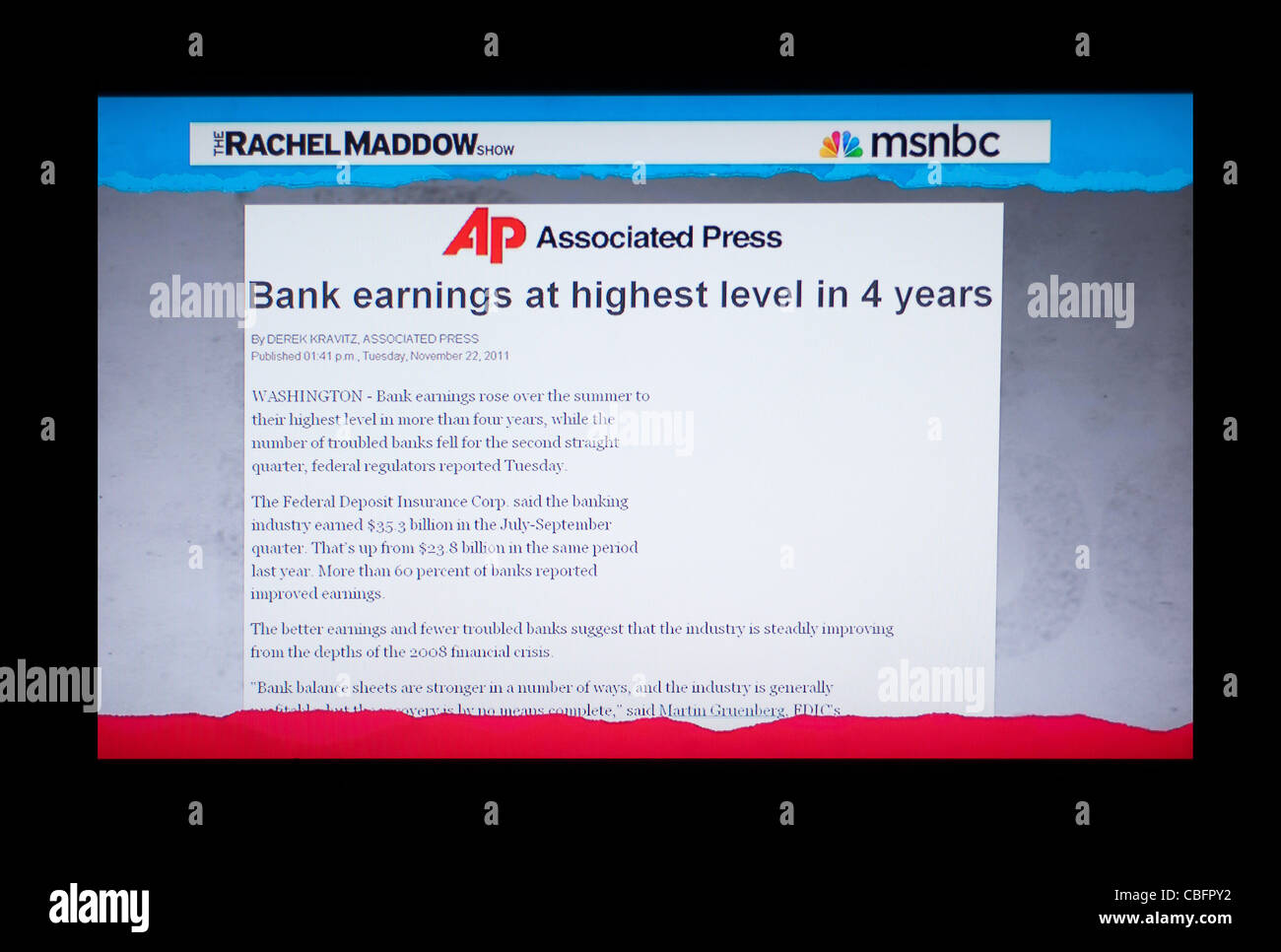 Associated Press article 'Bank earnings at highest level in 4 years' headline featured on the Rachel Maddow - Stock Image
